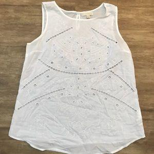 White sleeveless blouse
